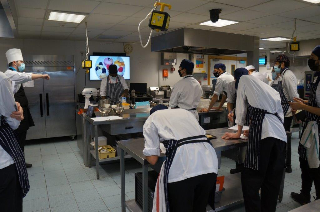 Catering students learn from patisserie expert